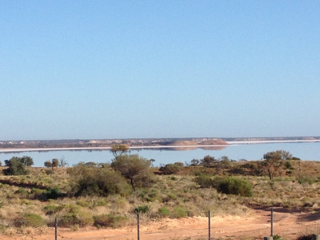 Lake Hart under a clear blue sky. Remember, it's not water, it's salt!